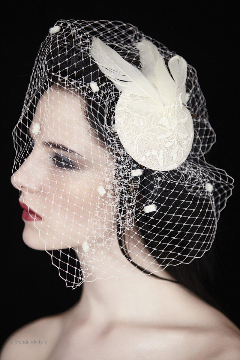 The Felicity Wedding Veil – feather fascinator and birdcage veil